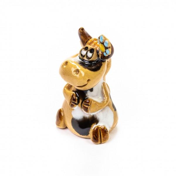 Keramik Minifigur - Kuh sitzend mit Blumen am Horn - gemischte Farben