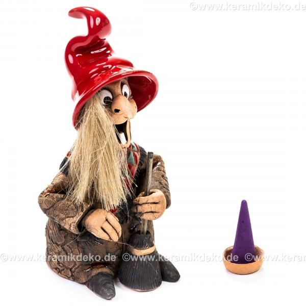 Hexe mit rotem Hut. Räuchermännchen.