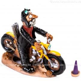 Motorradfahrer auf Motorrad. Räuchermännchen.