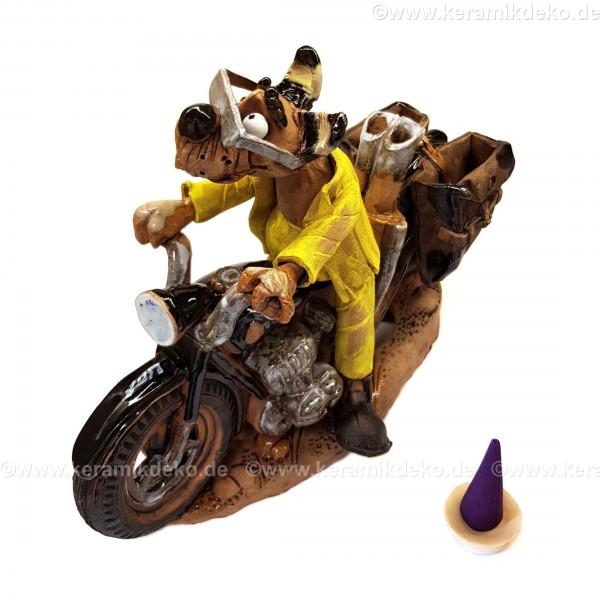 Motorradfahrer. Hund auf einem Motorrad. Räuchermännchen