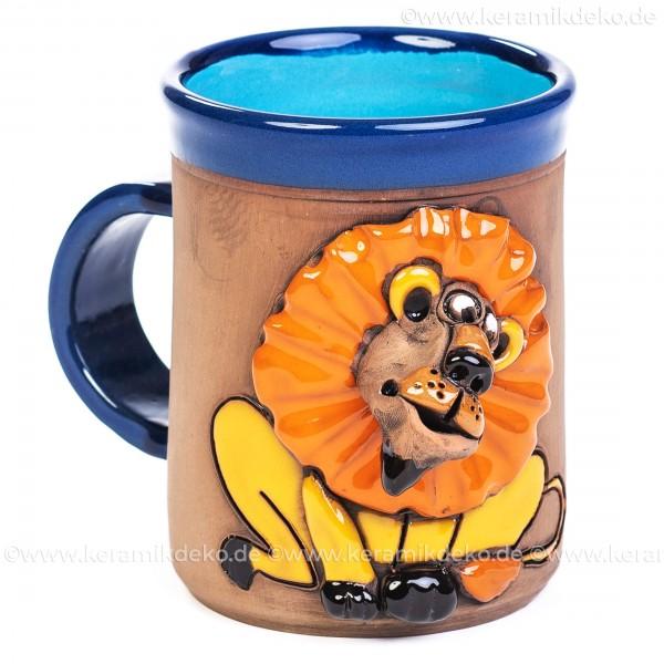 Blauer Keramikbecher mit Löwe